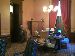 The previous picture was shot on my Google Glass, and unbeknownst to me, Jessi was taking a picture of me taking that picture! This angle also shows how the Speaker's office was already being torn down and boxed up, but he and I were still working, because there was still work to be done.